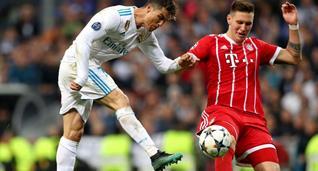 Никлас Зюле (справа) играет против Криштиану Роналду, Getty Images
