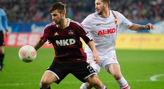 Симмонс (слева) сыграл за Нюрнберг 102 матча в Бундеслиге, Getty Images