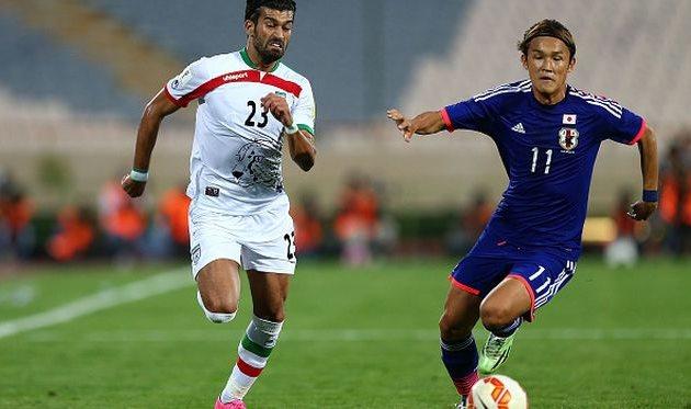 Такаси Усами (справа) в игре за сборную, Getty Images