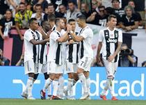 Игроки Ювентуса отмечают первый гол в ворота Лацио, Getty Images