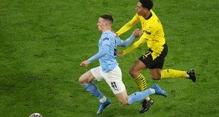 Фил Фоден против Джуда Беллингэма в ответной игре Боруссии Д и Манчестер Сити, Getty Images