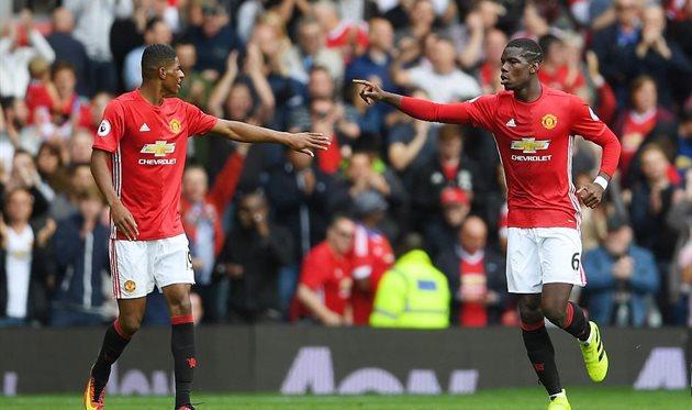 Поль Погба (справа) и Маркус Рашфорд попали в символическую сборную УЕФА, Getty Images