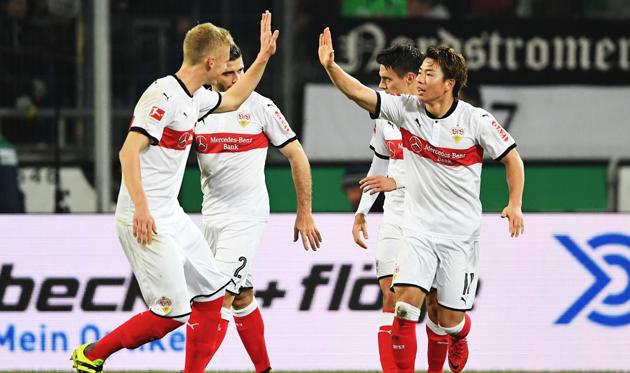 Такума Асано открыл счет в матче, Getty Images