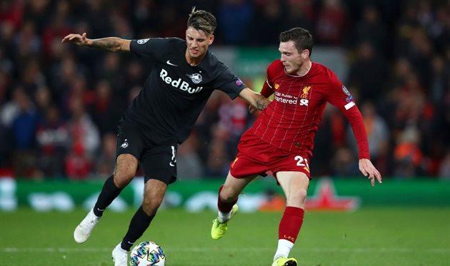 Доминик Собослаи (слева) в матче с Ливерпулем, Getty Images
