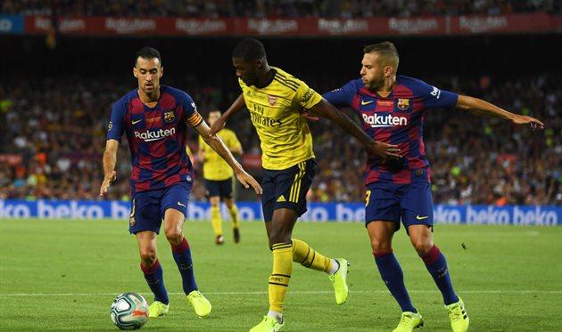 Серхио Бускетс и Хорди Альба в матче с Арсеналом, Getty Images