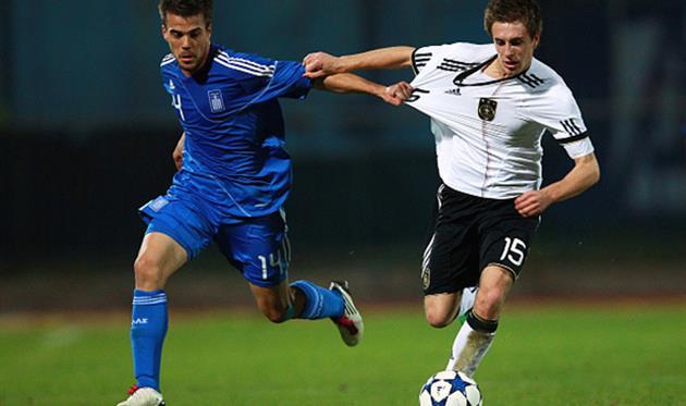 Никос Цуманис (слева), Getty Images