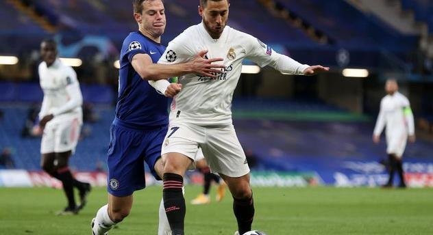 Сезар Аспиликуэта (слева) в матче против Реала, Getty Images